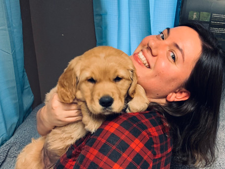 Sansa as a puppy and Janelle.jpeg