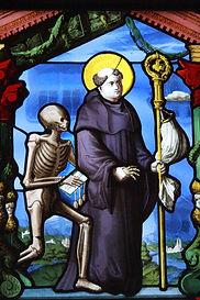 St. Fridolin and skeleton stained glass window Bad Sackingen Germany Switzerand
