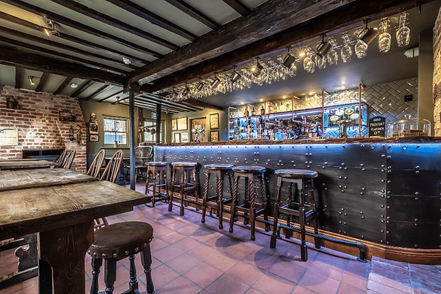 The bar at The Three Black Birds, Wooditton