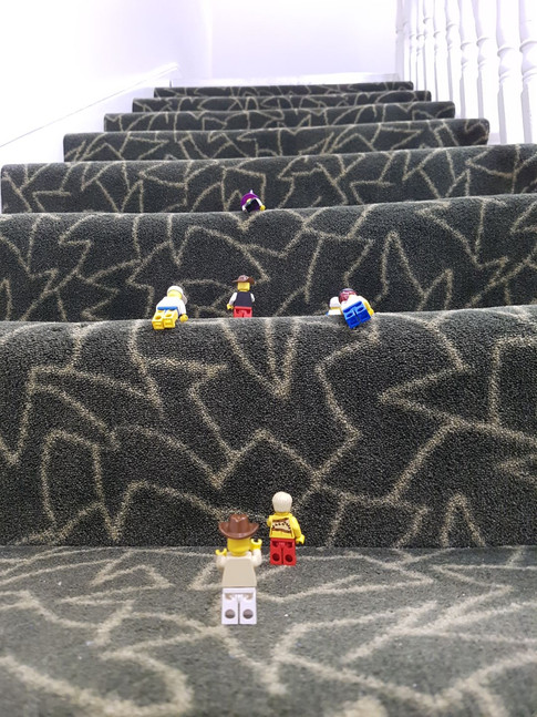 lego men climbing the stairs