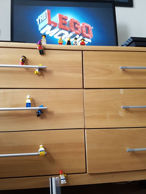 lego men climbing the drawers