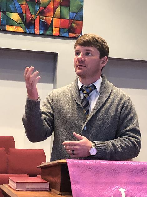Pastor Sam preaching service