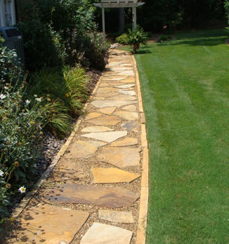 Natural stone pathway and maintained lawn