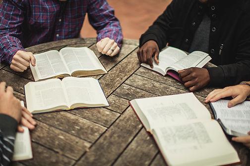men's hands, bibles round table.jpg