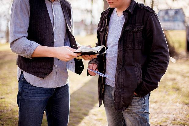 two men looking at bible_medium_laura_po