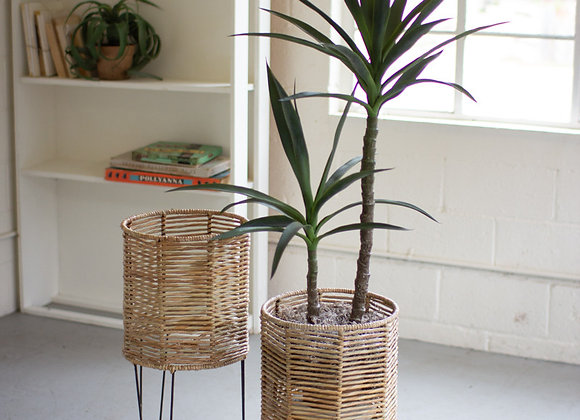 set of 2 round seagrass planters with iron bases