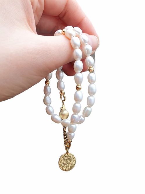Double white pearls bracelet with  gilded silver details
