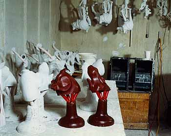 Notice the wax trees are then taken to what is known as the slurry room where the time consuming process of building the ceramic shell will begin.