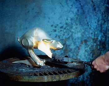 The completed metal sculpture is then heated with a torch in order to make it ready to receive patina.