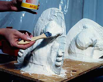 """A lock and tab system has been applied (see the edge) so that the mold will be able to be opened and closed securely. Once the rubber mold has been completed, a plaster or fiberglass """"mother"""" mold is applied to the outside which will preserve the integrity of the rubber mold."""