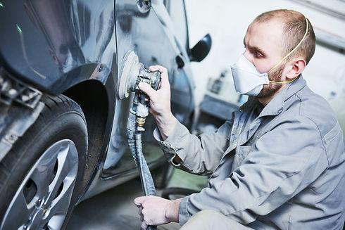 auto repairman grinding automobile car body.jpg
