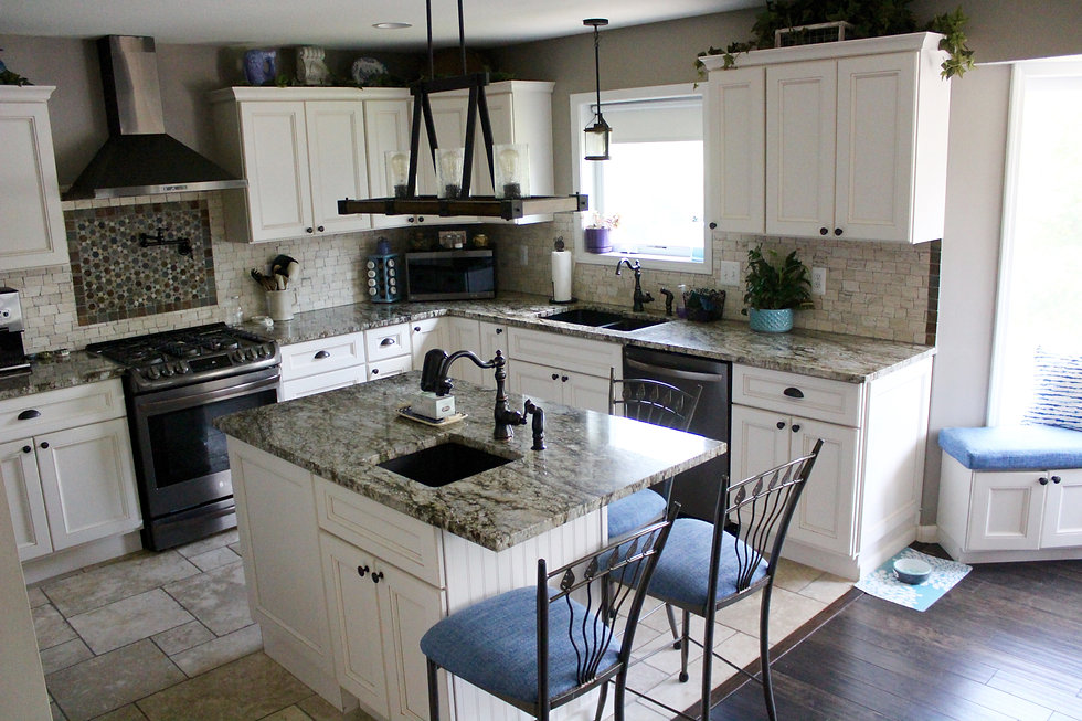 Bright timeless kitchen in Michigan with an island earth tone tile and white cabinets
