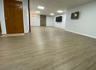 COREtec floor installed in a basement with a sliding barn door