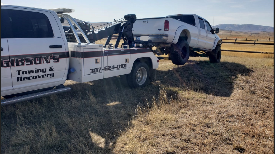Hook Truck Towing a Ford