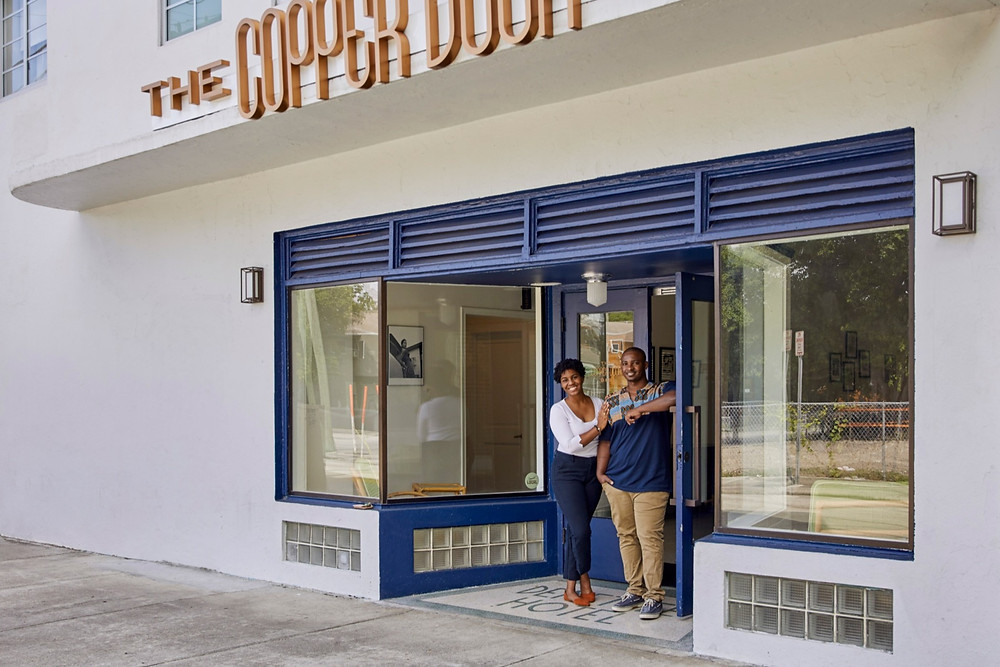 Owners Jamila Ross and Akino West stand proudly outside the Copper Door B&B