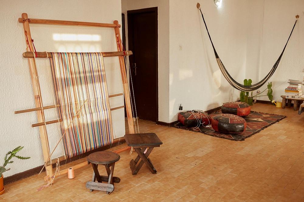 African design studio nmbello Studio using a weaving loom to craft design