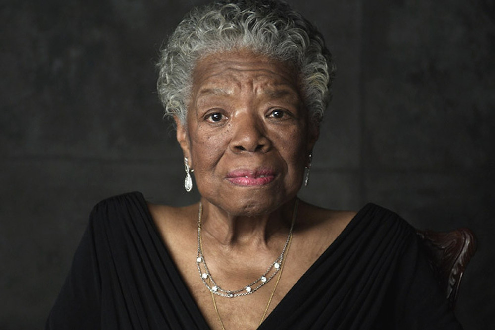 Portrait of African-American female poet Maya Angelou wearing a black dress in front of a black background