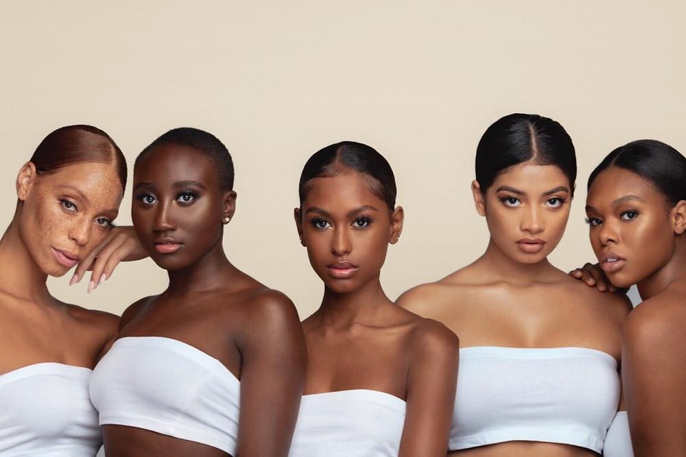 Black female models promoting Black owned vegan make up brand Range Beauty