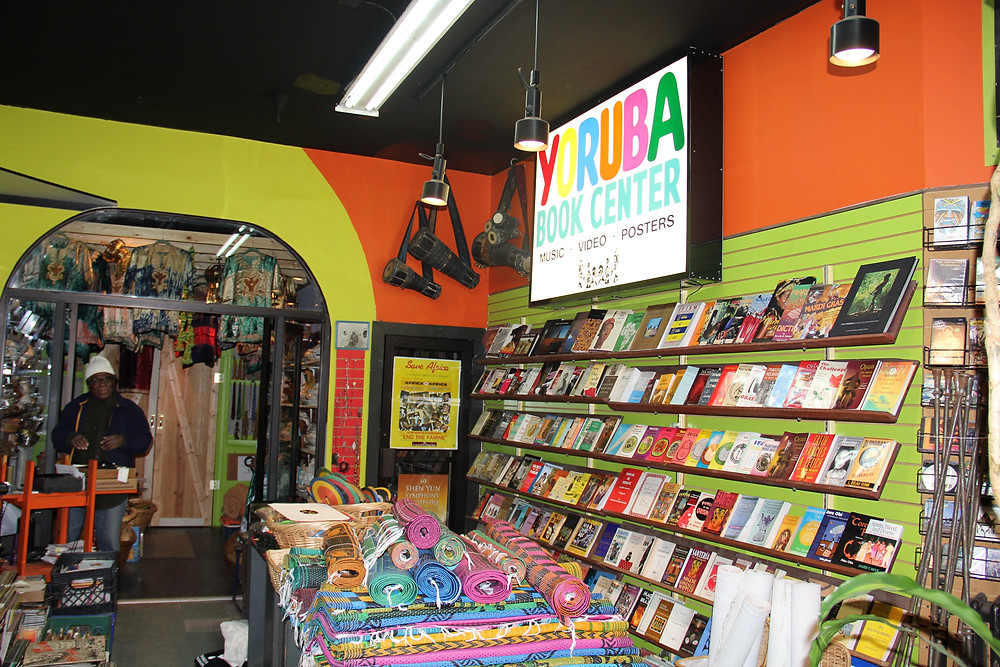 A photo of the bright and colourful interior of black-owned bookstore Yoruba Book Center that specialises in African spirituality