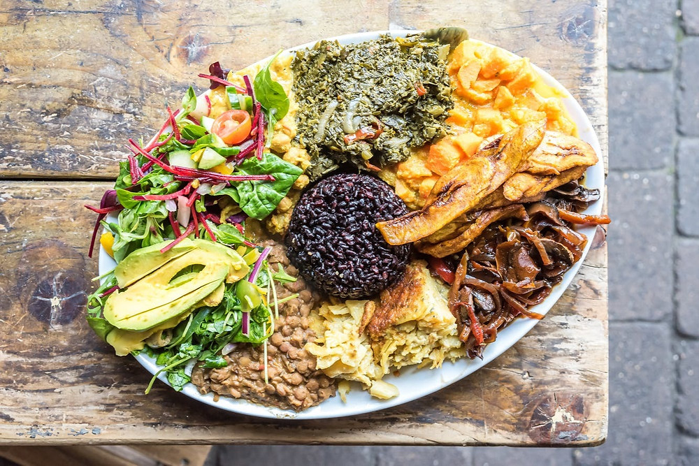 A plate of food from black owned vegan restaurant Eat of Eden