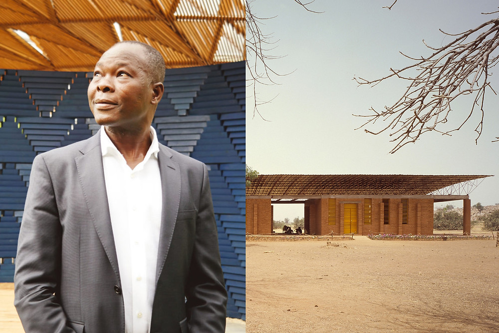 Black architect Diébédo Francis Kéré stands in front of the serpentine pavilion, along side of a contemporary African building which he designed.