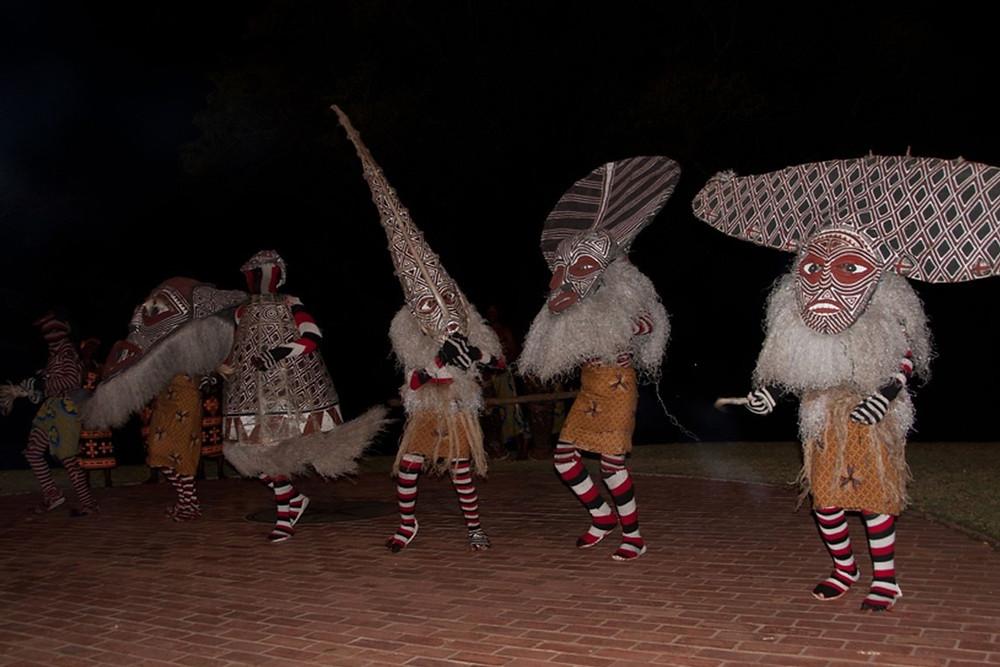 Performers celebrate The Makishi Masquerade in Zambia