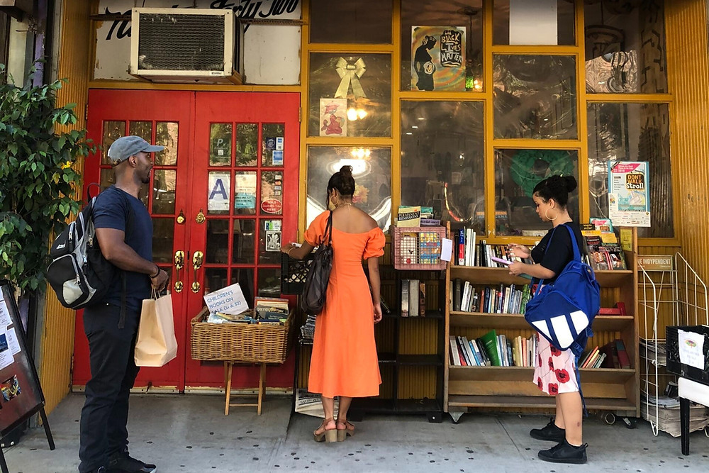 A photo of shoppers outside black-owned bookstore Sister's Uptown, located in New York