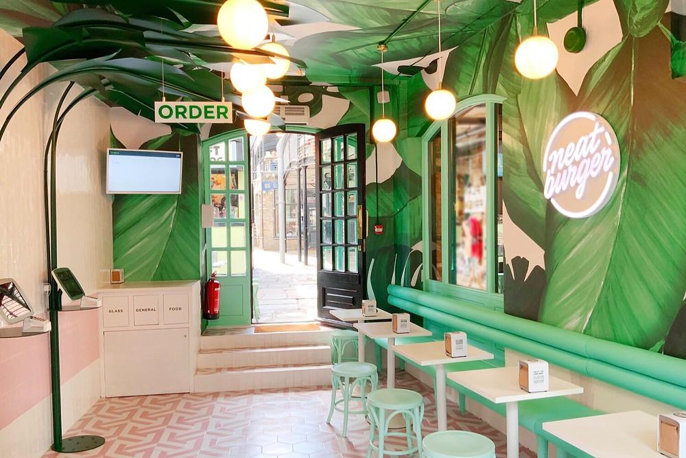 Inside decor of black owned vegan restaurant Neat Burger