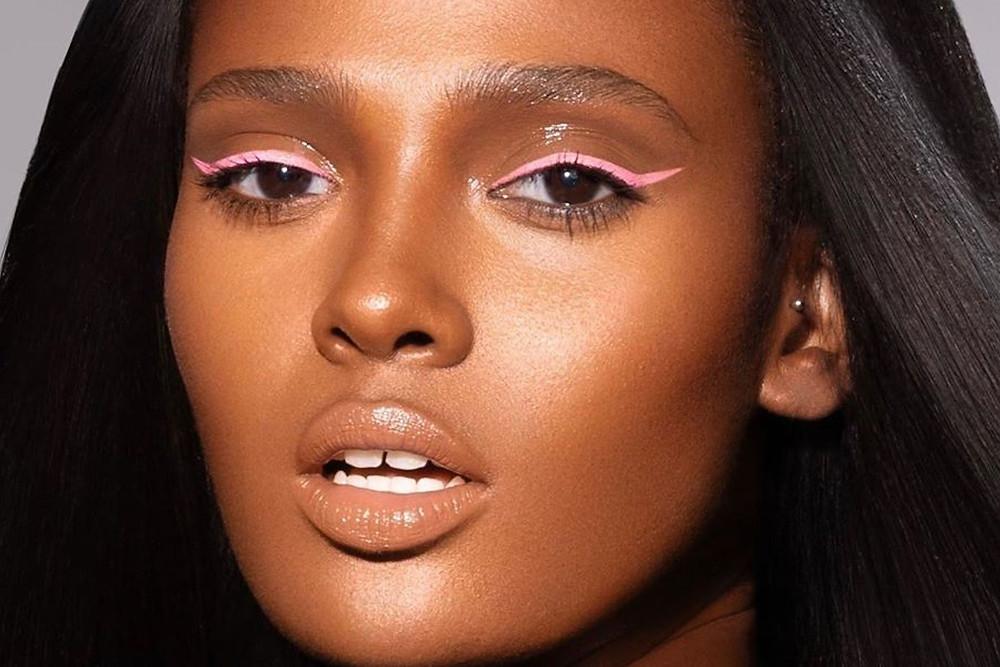 Black Female Model promoting Black owned vegan make up brand Danessa Myricks Beauty with pink eye liner