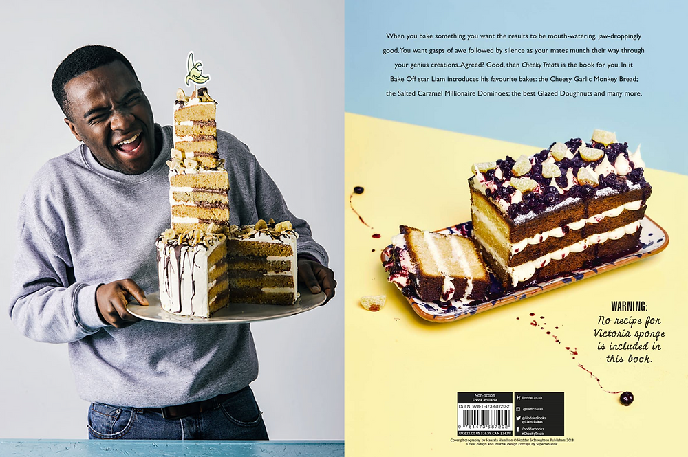 Black male baker Liam Charles on the cover of his cookbook Cheeky Treats and ham with a three tiered  banana chocolate cake