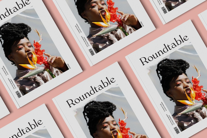 Multiple covers of Black owned British Magazine Roundtable featuring a black female model posing with a flower on a peach background