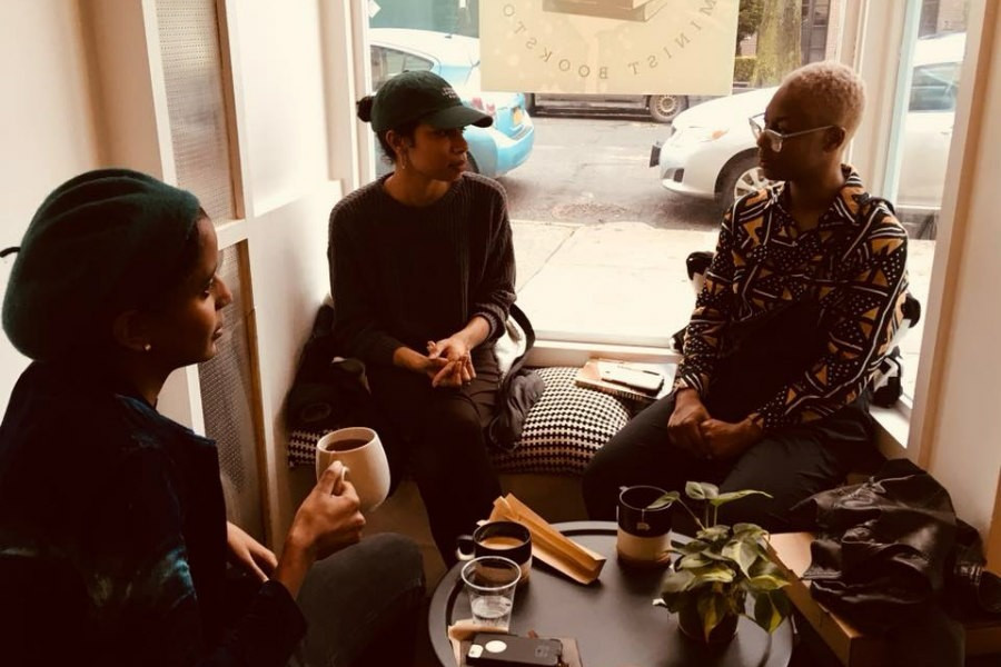 Readers and customers gather to discuss books at black-owned bookstore Cafe con Libros located in New York