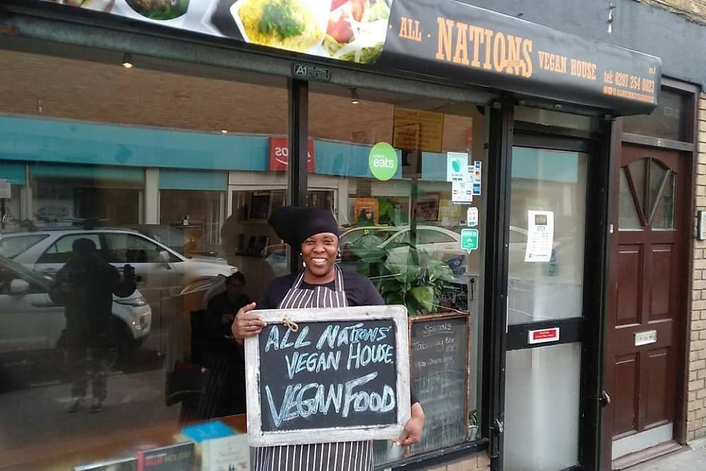 Owner Atreka Cameron in front of her vegan restaurant All Nations Vegan House