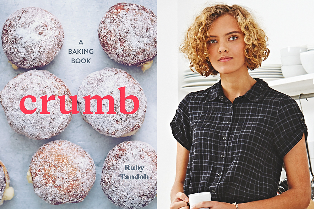 Black female baker Ruby Tandoh in the kitchen with her cookbook Crumb with donuts on the cover