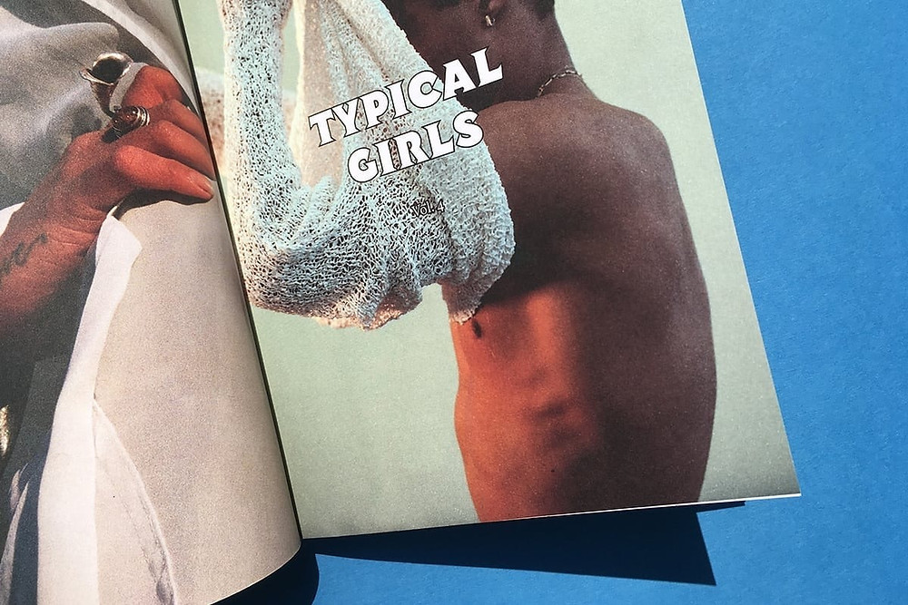 Black owned British Magazine Typical Girls featuring a black male model putting on a cream sweater