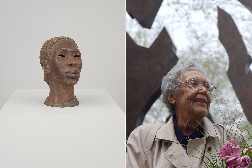 Artist Elizabeth Catlett Stands in front of sculpture next to bronze figurehead of a black woman