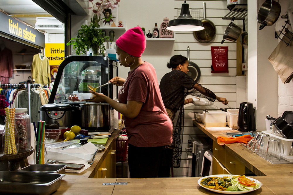 Chefs at black owned vegan restaurant Deserted Cactus dish up food for customers