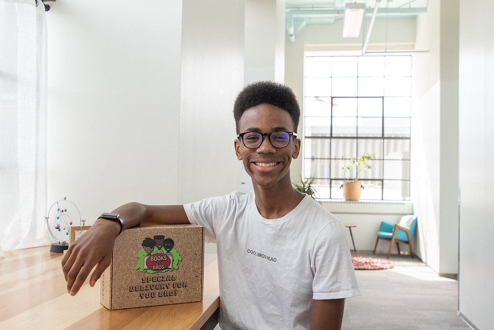 Black Book Club Books N Bros founder Sidney Keys III poses with subscription box