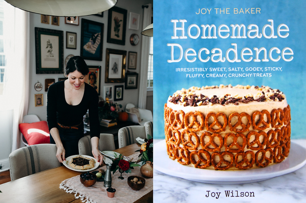 Black female baker Joy Wilson in her dining room with her cookbook Homemade Decadence and pretzel covered cake