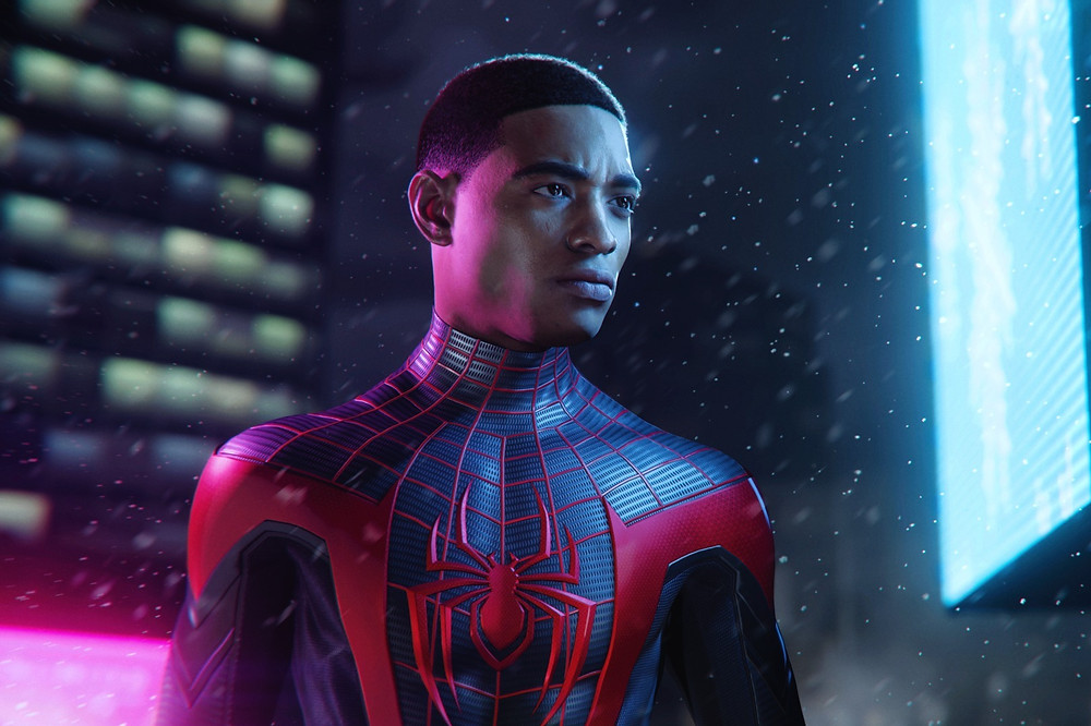 Black male video game character Miles Morales stands in snow in spiderman costume