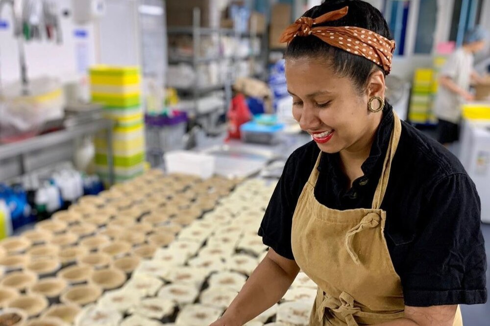 Owner of Young Vegans Carla Monsora smiles as she manufactures a large batch of pies