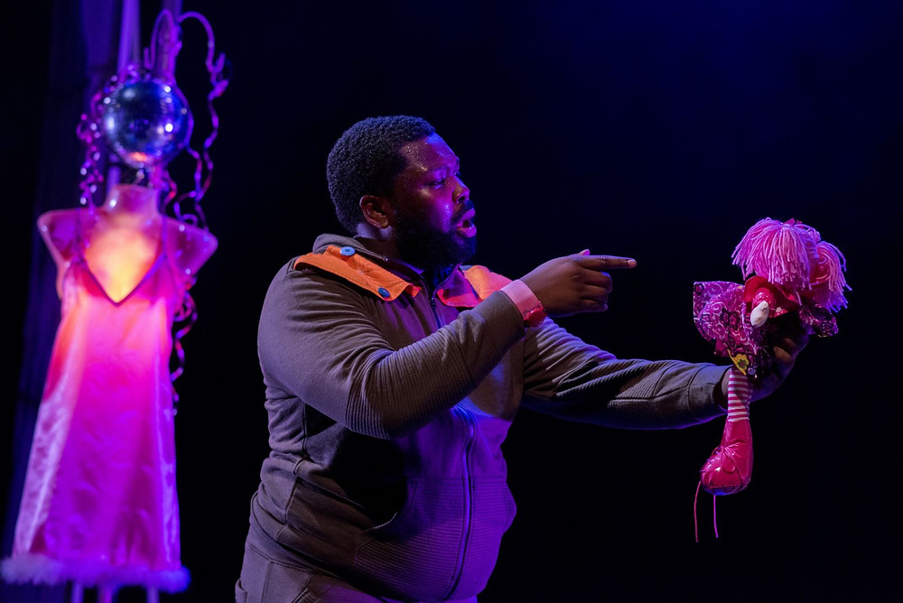 A black actor performs on stage for High Rise theatre collective