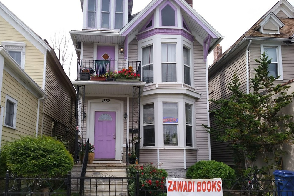 A photo of the purple painted house where the black-owned bookstore Zawadi Books is located in Buffalo New York