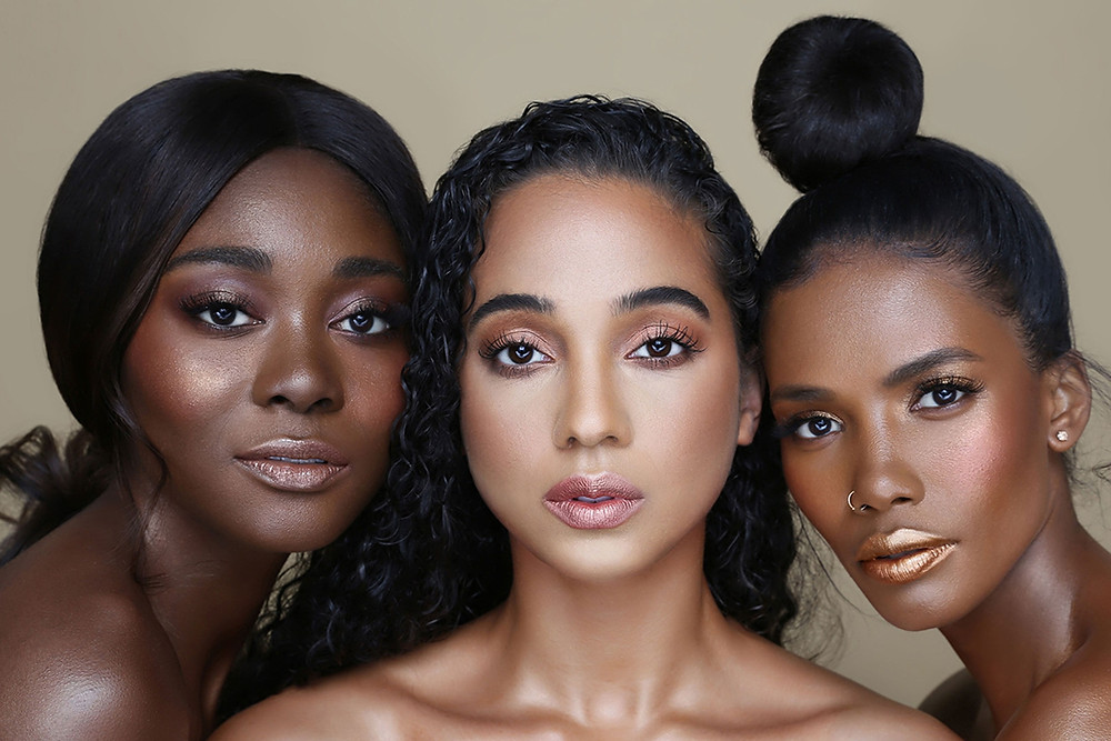 Three black female models promoting Black owned vegan make up brand The Lip Bar with contrasting shades of lipstick