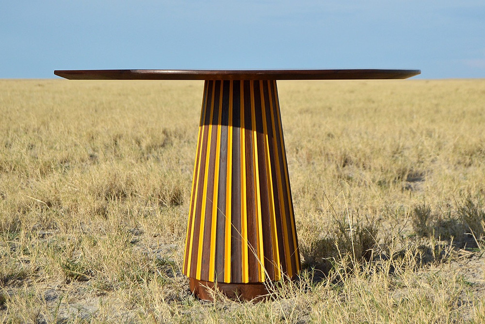 African based design studio Mabeo Furniture's table placed upon a field