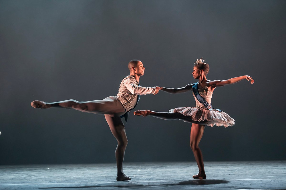 Black male and female ballet dancer dance on stage in costumes for Ballet Black