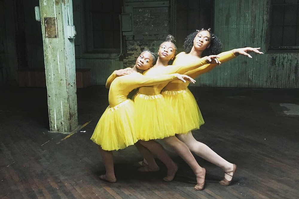 Three Young Black Ballet dancers in yellow tutus dancing in the documentary film Ballet After Dark