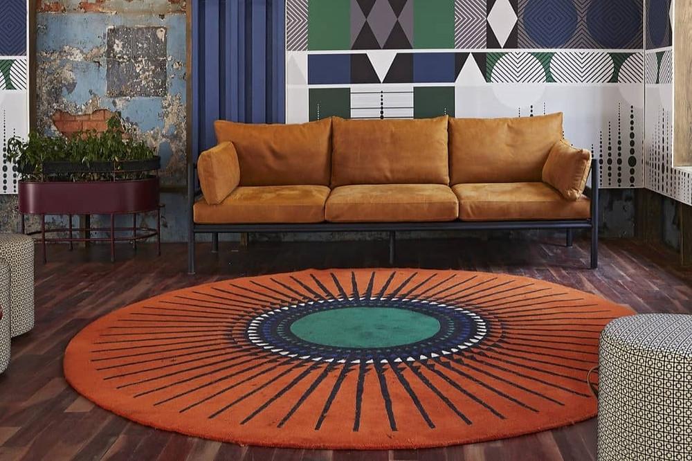 orange and green rug by African based studio Pinda Design
