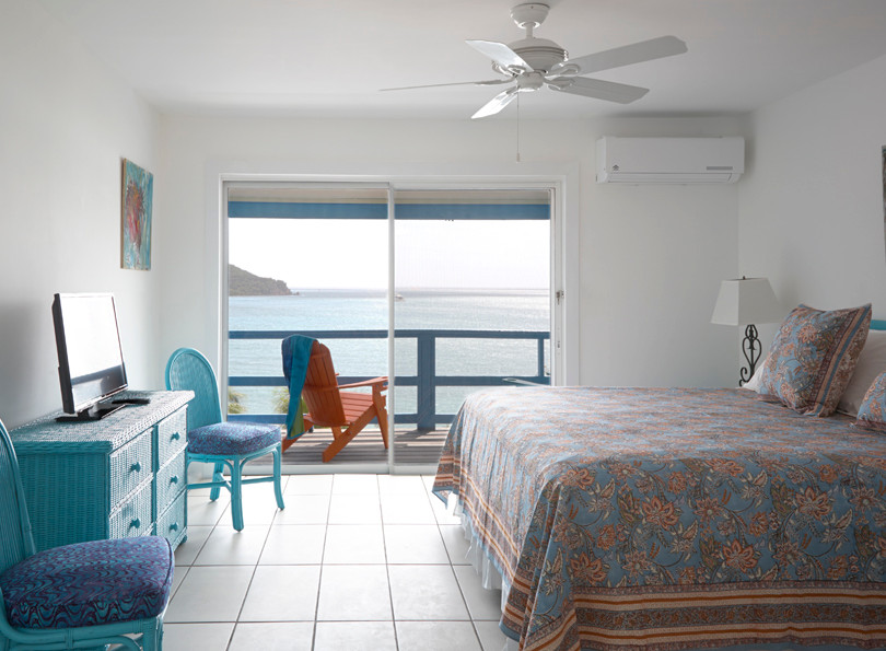 Welcome to Olga's Fancy Inn in the historic Frenchtown neighborhood of St. Thomas, USVI.  The hotel is a stone's throw to downtown Charlotte Amalie and equally short distance to our airport. While located in an eclectic, colorful neighborhood of shops, fine dining and entertainment, we can also boast a bit of seclusion.  Olga's Fancy is situated directly on a hillside along the waterfront and offers fabulous views of Hassel and Water Island all the way to St. Croix in the distance, as well as expansive views of the bustling St. Thomas harbor.  ​ As our rooms are nestled along the hillside, there are some stairs. Each landing offers a respite if needed, such as our covered terrace and our salt water pool.   Olga's Fancy is owned and operated by the Giovan family.  Recently, the Giovans set out to rehab and renovate the Inn.  The result is a charming and attractive Inn with bright, clean and comfortable rooms.