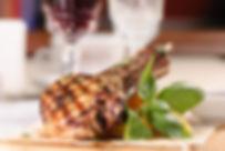 Rack of pork grilled with garnish.jpg